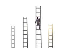 Les escaliers s'élevants d'homme d'affaires d'isolement sur le blanc Images stock