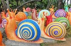 Les escargots géants synthétiques comme décoration de jardin dans le jardin tropical de Nong Nooch à Pattaya Images libres de droits