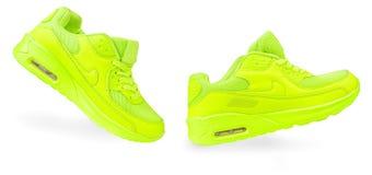 Les espadrilles vert clair ont isolé le fond blanc isolat de chaussures de sports Image libre de droits