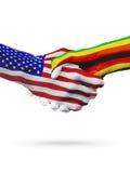 Les Etats-Unis et coopération de concept de drapeaux du Zimbabwe, affaires, compétition sportive Photographie stock libre de droits