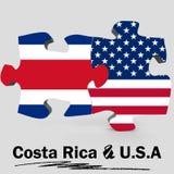 Les Etats-Unis et drapeaux de Costa Rica dans le puzzle Images stock
