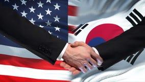 Les Etats-Unis et poignée de main de la Corée du Sud, amitié internationale, fond de drapeau banque de vidéos
