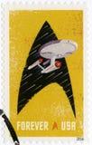 Les ETATS-UNIS - 2016 : montre l'entreprise de Starship à l'intérieur du contour des insignes d'un Starfleet photographie stock libre de droits