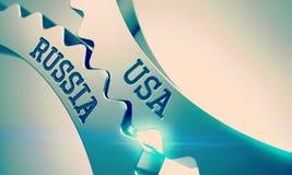 Les Etats-Unis Russie - texte sur le mécanisme des vitesses brillantes en métal 3d Photographie stock libre de droits