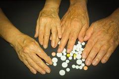 Les experts avec des pilules Photos stock