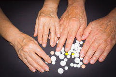 Les experts avec des pilules Photographie stock libre de droits