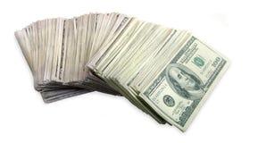 les factures que le dollar a éventé cents des empilent à l'extérieur photos stock