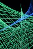 Les feux bleus et verts ont créé la formation 3D dans le noir Photo stock