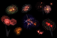 Les feux d'artifice abstraits allument le ciel foncé Photos libres de droits