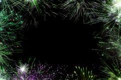 Les feux d'artifice encadrent au fond noir Image libre de droits