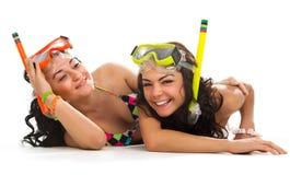 Les filles apprécie dans le masque avec la prise d'air Image stock