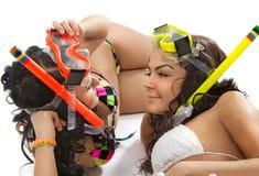 Les filles apprécie dans le masque avec la prise d'air Photographie stock libre de droits