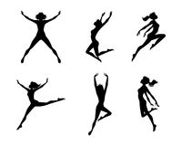 les filles sautant des silhouettes Photos stock