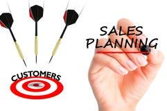 Les flèches de vol à l'des clients visent suggérer la planification de ventes Photographie stock libre de droits
