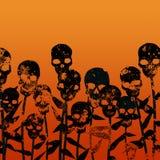 Les fleurs sont les crânes nés Photo libre de droits