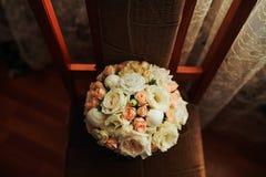 Les fleurs sur la chaise Image libre de droits