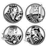 Les formes rondes avec des visages de jouer carde des caractères dans le noir et Photographie stock libre de droits