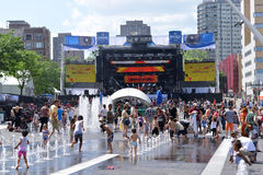 Les FrancoFolies de Montréal. Children cool off in the fountains on a hot day at the annual Les FrancoFolies de Montréal festival at Place des Arts Stock Photography