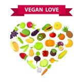 Les fruits et légumes ont placé sous une forme de coeur, amour de vegan Image libre de droits