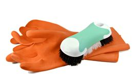 Les gants en caoutchouc et frottent le balai photo libre de droits