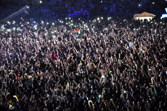 Les gens à un concert vivant Photographie stock