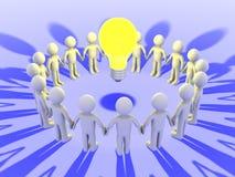 Les gens autour d'une ampoule Photographie stock libre de droits