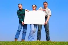 Les gens avec avec la page blanche Image libre de droits