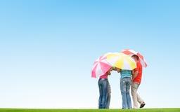 Les gens avec des parapluies Images libres de droits