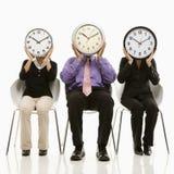 Les gens avec des visages d'horloge Photographie stock