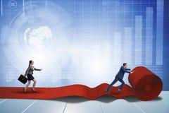 Les gens d'affaires dans le concept de succès avec le tapis rouge Photographie stock
