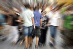 Les gens dans la tache floue Photo stock