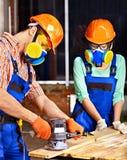 Les gens dans le casque de constructeur. Photo libre de droits