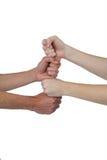 Les gens empilant leurs poings Images libres de droits