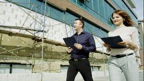 Les gens et construction en construction Images stock
