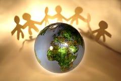 Les gens et le globe Image stock