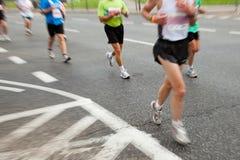 Les gens exécutant dans le marathon Photographie stock