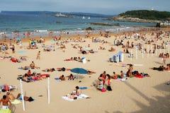 Les gens sur la plage Photographie stock