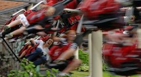 Les gens sur les montagnes russes Photo libre de droits