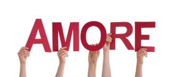 Les gens tenant Amore Images libres de droits