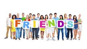Les gens tenant les amis de Word Image libre de droits