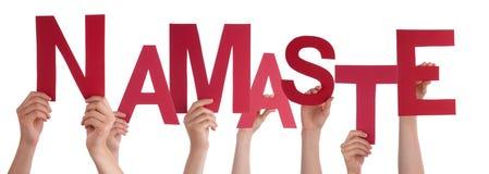 Les gens tenant Namaste photos stock