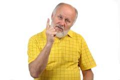 Les gestes de l'homme chauve aîné Images stock