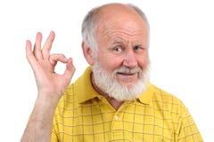 Les gestes de l'homme chauve aîné image libre de droits