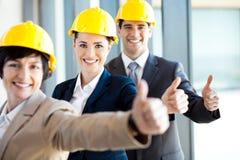Les gestionnaires de construction manie maladroitement vers le haut Photographie stock libre de droits