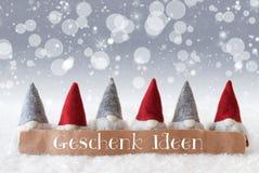 Les Gnomes, fond argenté, Bokeh, étoiles, Geschenk Ideen signifie des idées de cadeau Photo stock