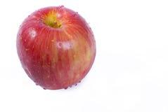 les gouttelettes de pomme ont isolé le blanc Photos libres de droits