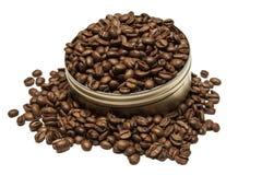 Les grains de café peuvent dedans Image stock