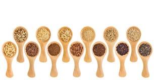 Les grains gratuits et les graines de gluten - administrez le résumé à la cuillère photographie stock libre de droits