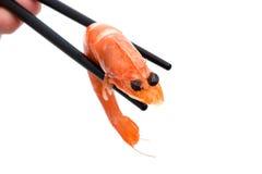 les grandes baguettes ont pris des sushi de crevette Photos stock