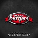 Les hamburgers délicieux se boutonnent sur le fond en cuir Photos libres de droits